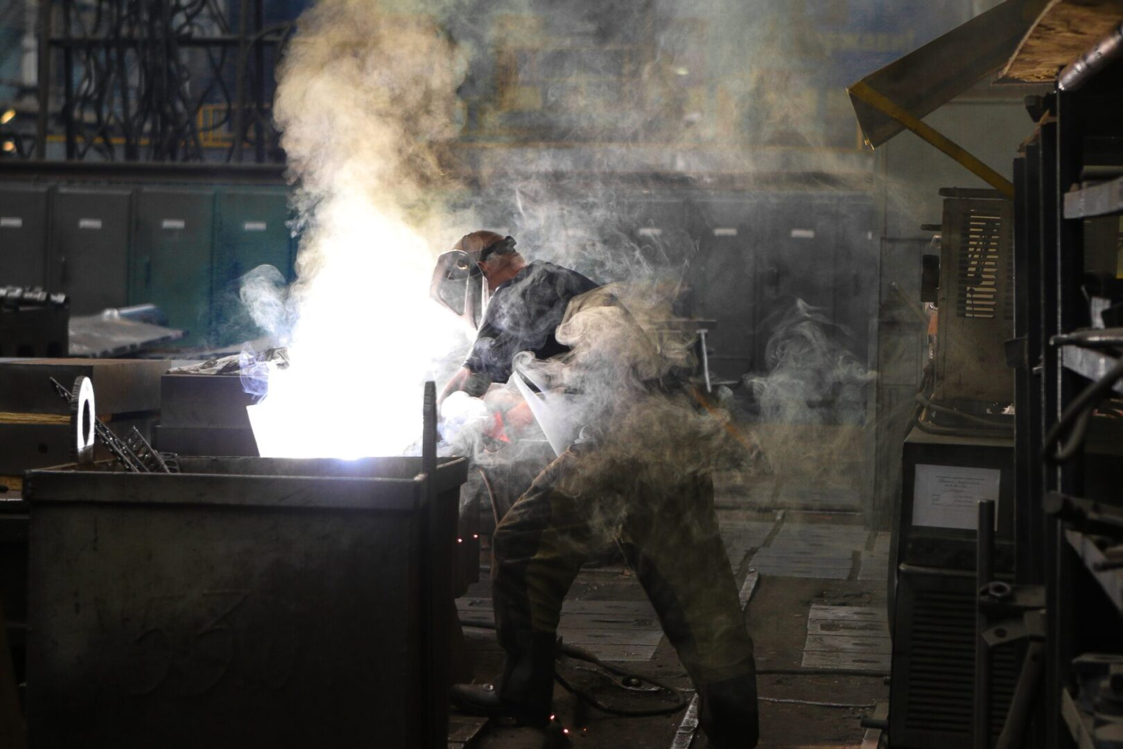 man-wearing-gray-shirt-and-welding-mask-covered-in-welding-2760344